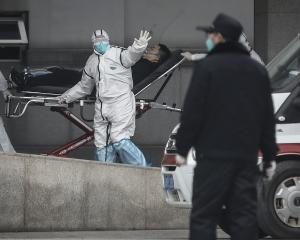 Chinese authorities say nearly 50 people are known to have been infected by the outbreak. Photo:...