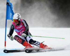 New Zealander Harrison Messenger competes in the first round of the men's giant slalom at the...