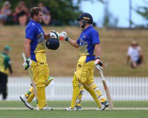 Otago Volts batsman Dean Foxcroft is congratulated by team-mate Dale Philips after scoring a...