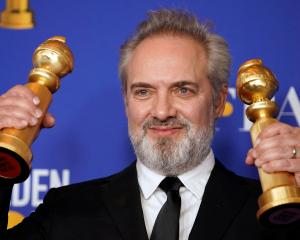 Sam Mendes poses backstage with his awards for Best Director - Motion Picture and Best Motion...