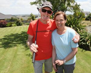 Barry and Helen Grant on their backyard mini-golf course. Photo: Geoff Sloan