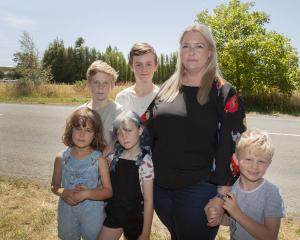 Angela Jones with Aria Hamilton-Petrie, 8, and her children Cody Jones, 11, Sienna Jones, 8,...