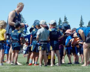 Highlanders lock Josh Dickson picks his team in a rippa rugby match in Wanaka yesterday. About 70...