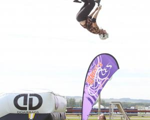 Andrew Nilbett entertains at the Winton A&P Show on Saturday by performing stunts in front of...