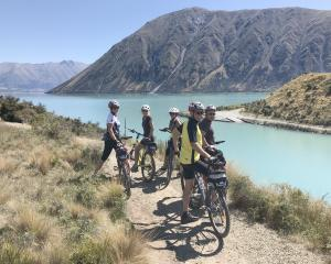 Cycling alongside picturesque Lake Ohau. PHOTOS: LINDY DAVIS
