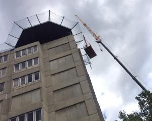 Contractors replace safety netting around the helipad at Dunedin Hospital yesterday. Photo:...