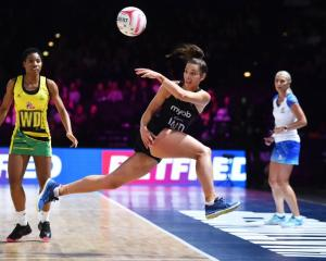 Karin Burger saves a loose ball for the Silver Ferns against Jamaica this morning in their...