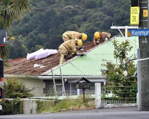 Part of Kenmure Rd, in Dunedin, was closed for a time late this afternoon, when roofing iron was...