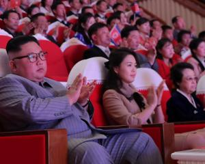 Kim Jong Un and his wife Ri Sol Ju  with aunt Kim Kyong Hui watch a performance to celebrate the...