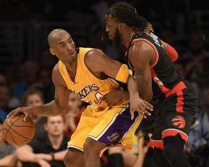 Lakers guard Kobe Bryant posts up Raptors forward DeMarre Carroll in a recent game at the Staples...