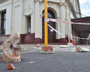 Masonry fell from the Allied Press building last night. Photo: Gerard O'Brien