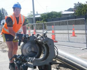 Central Otago District Council contractor Michael Harvey is all smiles yesterday as work on the...