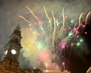 Fireworks light up the night sky over the Octagon as Dunedin welcomes the new year. PHOTO: GERARD...