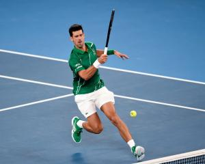 Novak Djokovic plays a shot during his quarterfinal win at the Australian Open. Photo: Getty Images