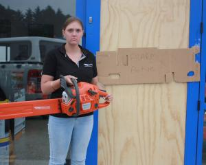 Johnson Gluyas Tractors parts consultant Piper Beach holds a Husqvarna chainsaw similar to those...