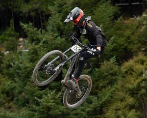 Ben Sziranyi, of Blenheim, flies high in a downhill race at the Oceania championships at Signal...