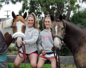 Samantha Gillies (left) with Junior Disco and Emma Gillies with Benrose Playtime relax at home on...