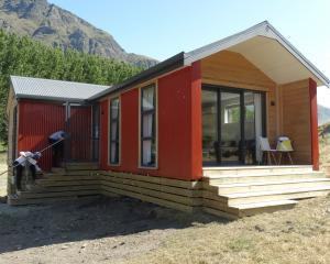 One of the three houses Real Journeys has built at its Walter Peak High Country Farm tourist...
