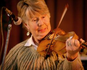 Noelene Tait, of Queenstown, pictured playing the violin in 2011. Mrs Tait was killed in a car...