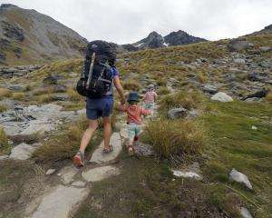 A Queenstown family heads to Lake Alta in the Remarkables Conservation Area. Photo: Guillaume...