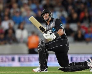 Ross Taylor plays a sweep shot during the Black Caps twenty20 against India at Eden Park. Photo:...