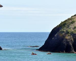 Emergency services search for a person missing in the water by Second Beach, near St Clair, in...