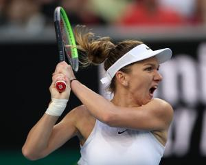 Simona Halep plays a shot in her match against Jennifer Brady at the Australian Open in Melbourne...