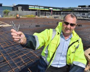 Anzor account manager Steve Fitzgerald holds up the supplier's products for new premises on...