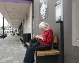 Gisela Andrew, of Dunedin, waits for her bus at the Great King St hub on Tuesday. PHOTO: JESSICA...
