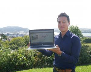 Dunedin City Council policy analyst Junichi Sugishita holds a laptop showing the new interactive...
