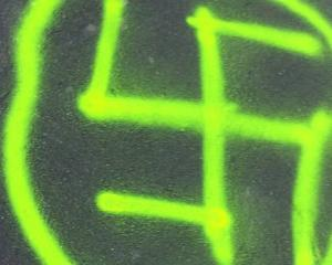 One of the swastikas painted on the footpath on The Terrace. Photo: NZ Herald