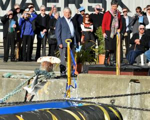 David Faulkner and Jo Plunket cut the ribbon during the launch of Port of Otago tug Taiaroa at...