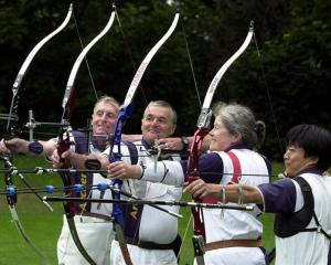 The 2004 Dunedin archery team of (from left) Ivan Powley, Garry Porter, Ann Holmes and Makoto...