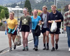 Removing rubbish from Dunedin streets, beginning in Royal Tce yesterday, are students (from left)...