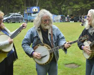 Enjoying a jam session on their banjos at the Whare Flat Folk Festival yesterday were (from left)...