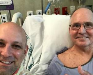 Barry Kohn (left) and brother-in-law Rick Reed, who is in Middlemore Hospital with wife Ivy Kohn...