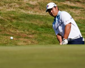 New Zealand Open leader  Joohyung Kim, of South Korea, plays on to the green at The Hills during...