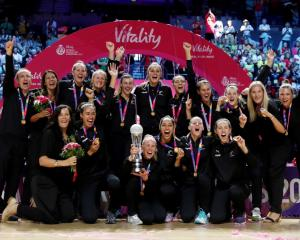The Silver Ferns celebrate with the trophy after winning the World Cup. Photo: Reuters