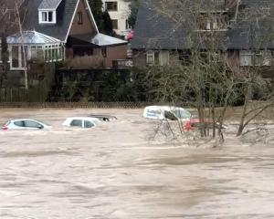 Cars were swept away by floodwaters after the River Wye broke its banks, in Hay-on-Wye, Wales....