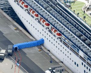 Passengers disembarking from the Diamond Princess cruise ship docked at Yokohama Port. Photo:...