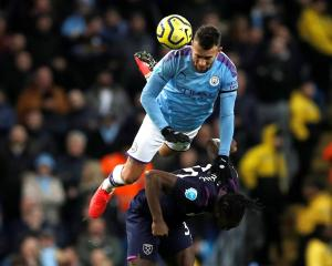 Manchester City's Nicolas Otamendi in action with West Ham United's Michail Antonio. Photo:...