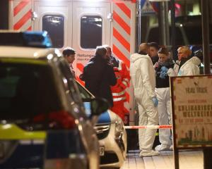 Forensic experts at work outside a shisha bar in Hanau following the shooting. Photo: Reuters