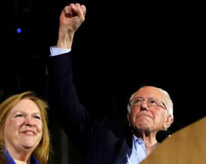 Democratic US presidential candidate Senator Bernie Sanders and this wife Jane take the stage at...