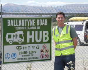 Responsible camping ambassador Neco Wieringa helps visitors know the rules at Wanaka's service...