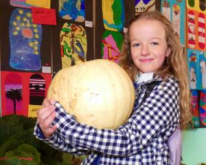 Showing off her prize-winning pumpkin is Marissa Crawford, of Roxburgh. PHOTO: SIMON HENDERSON