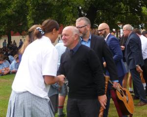 Ashburton College head of maori Tipene Philip leads the way in the hongi, a traditional Maori...