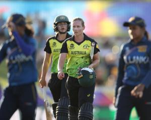 Australian batters Ellyse Perry (left) and Meg Lanning leave the field after finishing a nervy...