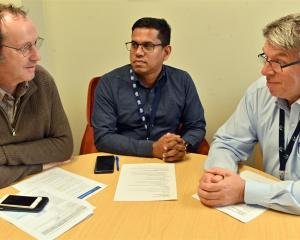 Reviewing coronavirus preparations are (from left) WellSouth medical director Stephen Graham,...