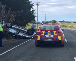 A car rolled after a crash on Kennington-Waimatua Rd today. Photo: Luisa Girao