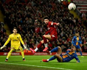 Liverpool's Curtis Jones in the air during the side's win over Shrewsbury Town this morning....